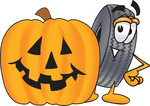 0025-0803-0310-0053_clip_art_graphic_of_a_tire_character_with_a_carved_halloween_pumpkin.jpg