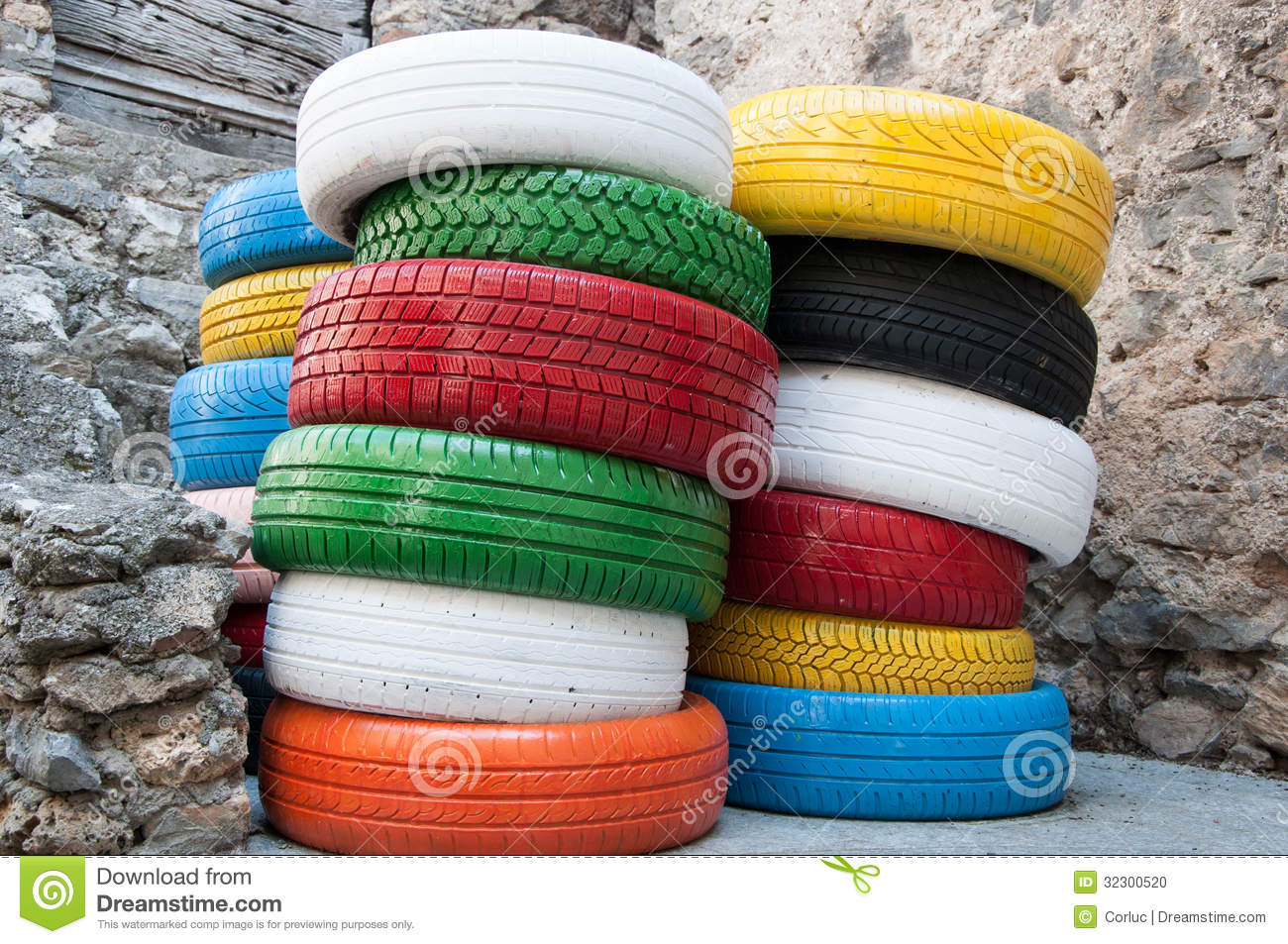 colored-tyres-some-old-standing-outside-workshop-32300520.jpg