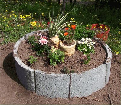 Hacer una jardinera rpido y por 2 euros con arcos de hormign foto