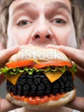 stock-photo-14633806-young-man-eating-tire-burger-studio-shot.jpg